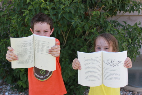 Kids holding open books