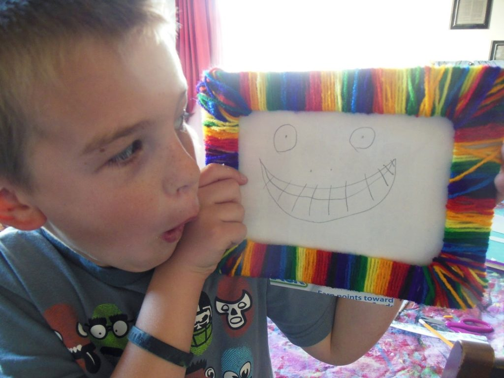 Kid making wow face at his finished frame